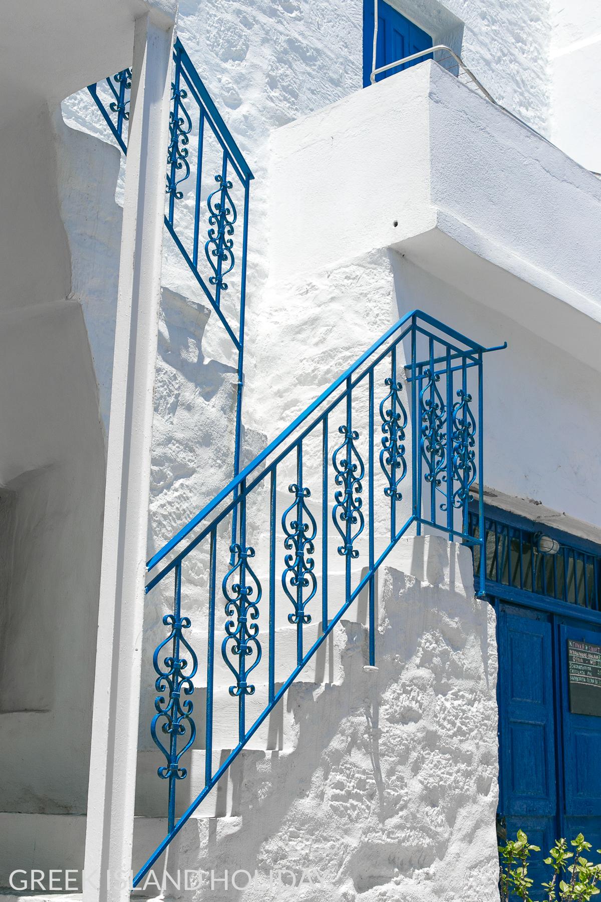 Greek Island Holiday blog Kimolos Chorio blue wrought iron staircase